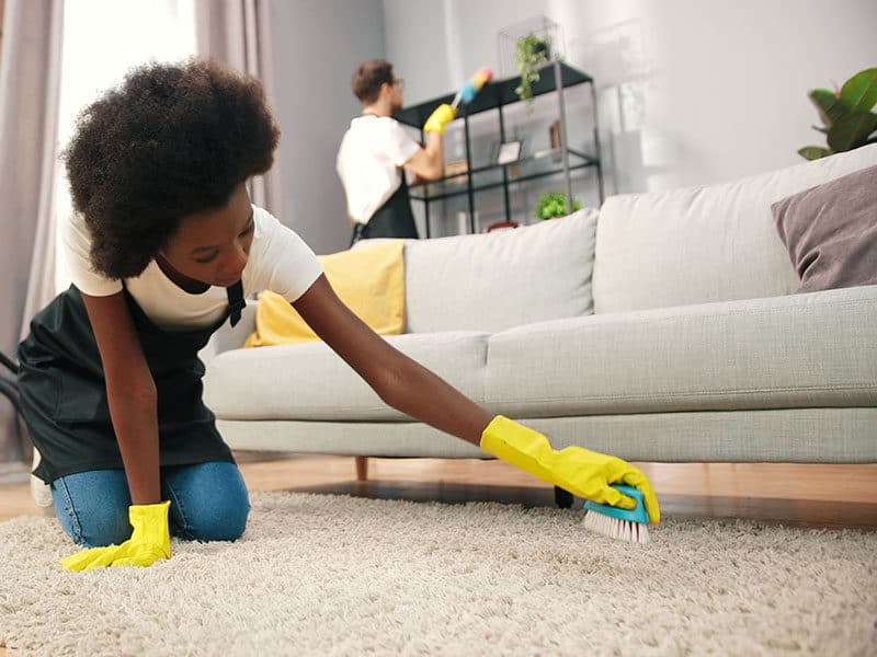 Women Clean Carpet