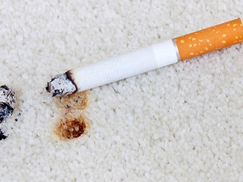 Burning Cigarette on Carpet