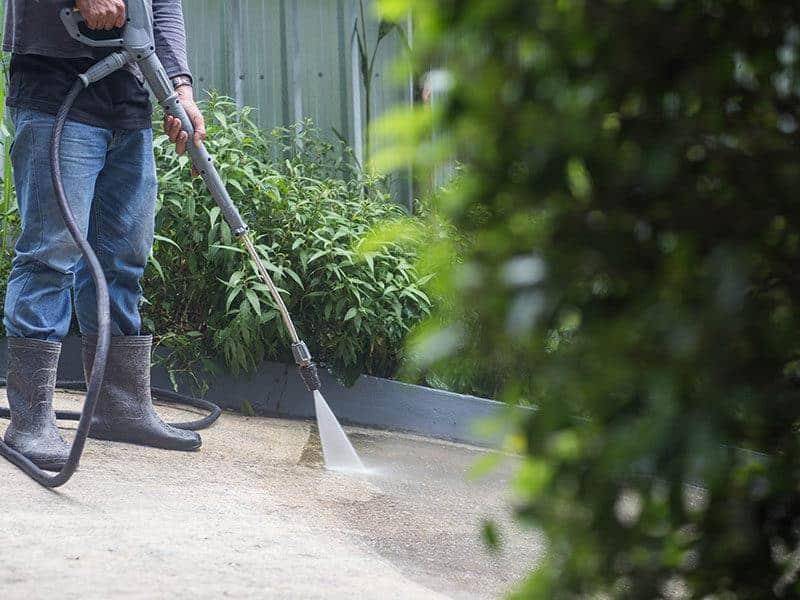 Man Clean Concrete Floors